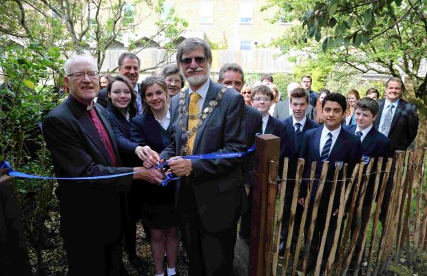Lord Carey, left, and Cllr Rod Cooper open the woodland walkway, watched by staff and pupils