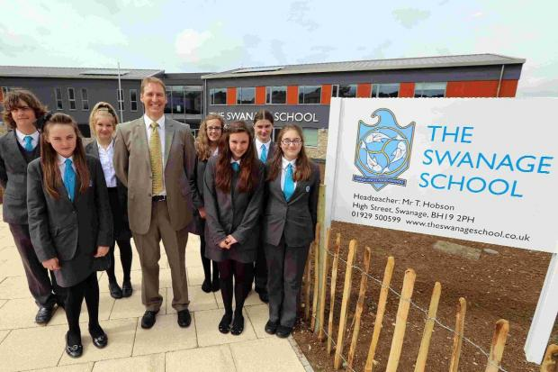 NEW BUILD: Head teacher Tristram Hobson and students from the new Swanage School