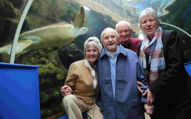 BIRTHDAY OUTING: Ted Webber with friends, left to right, Linda Wales and Alan and Mary Bean at the Oceanarium
