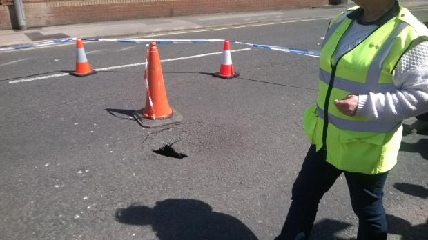 Bournemouth Echo: Part of Boscombe road cordoned off after hole appears