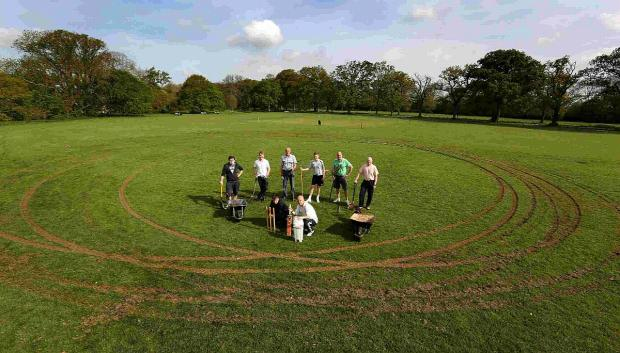 UNUSABLE: Steve Maine and members of the Kingston Lacy Cricket Team  on Pamphill Green, which has been damaged