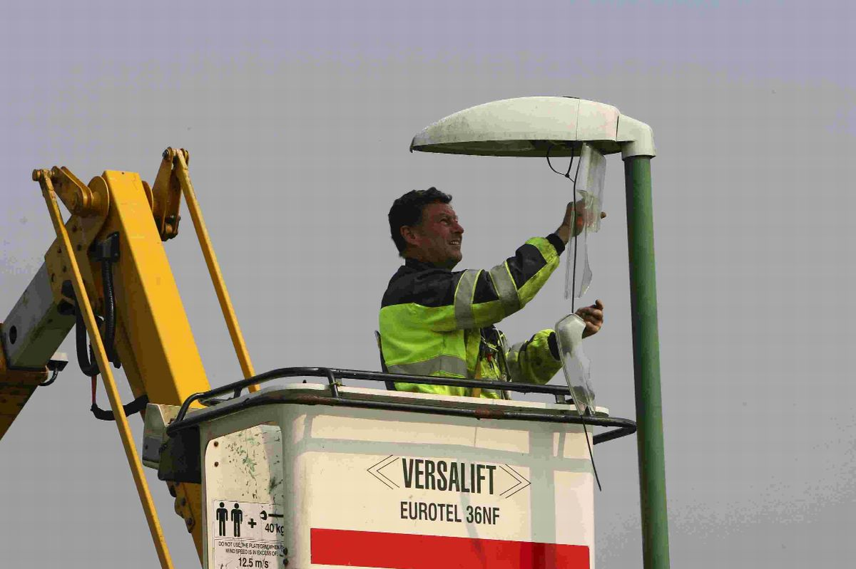 STRATEGIC: An electrical contractor  works on repairing street lights