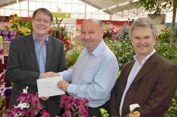 WELL DESERVED: Colin Brickell is presented with gift vouchers for his long service