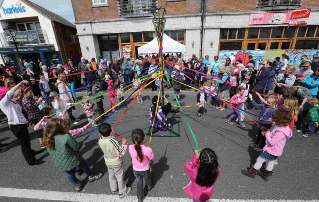 DANCE STANCE: Children dancing around the maypole to the sounds of Anonymous Morris