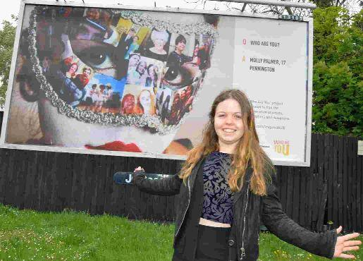 GREAT FEELING: Molly Palmer and her winning photo on a billboard in Barrack Road, Christchurch