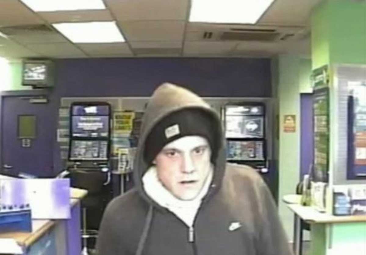 CCTV released in hunt for robber who raided Bournemouth bookmakers armed with knife