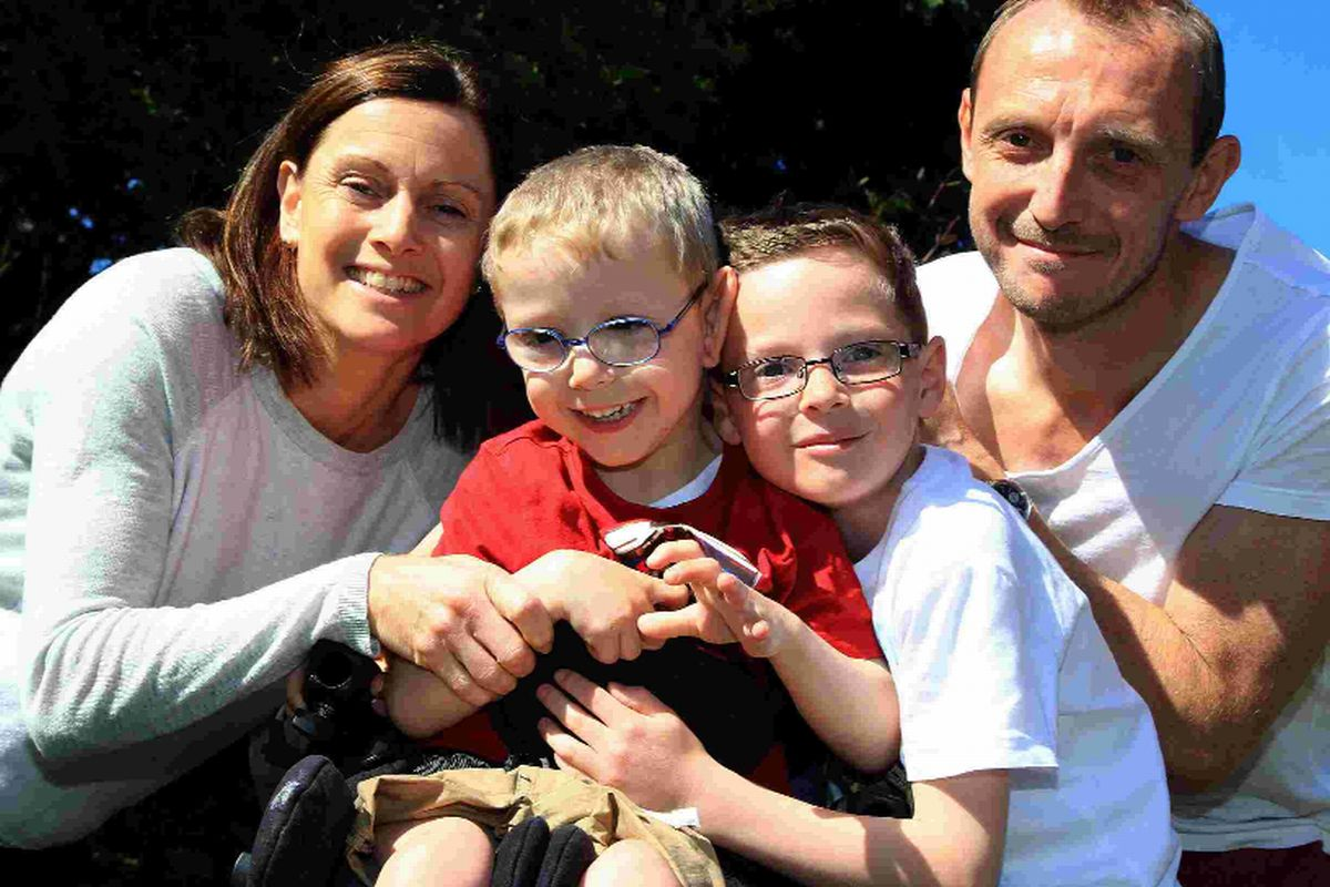 Parents complete mud run for disabled son
