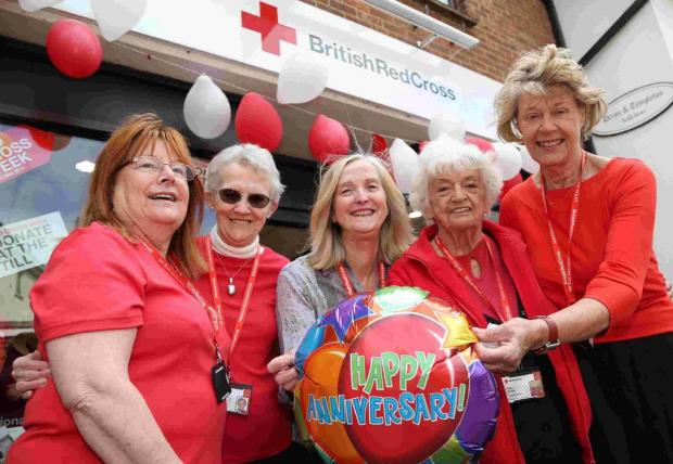BIG DAY: British Red Cross Ringwood shop Manager Jenny Melbourne, centre, and volunteers, from left, Pauline Dickenson, Lena Layton, Joan Browne and Di Mavor