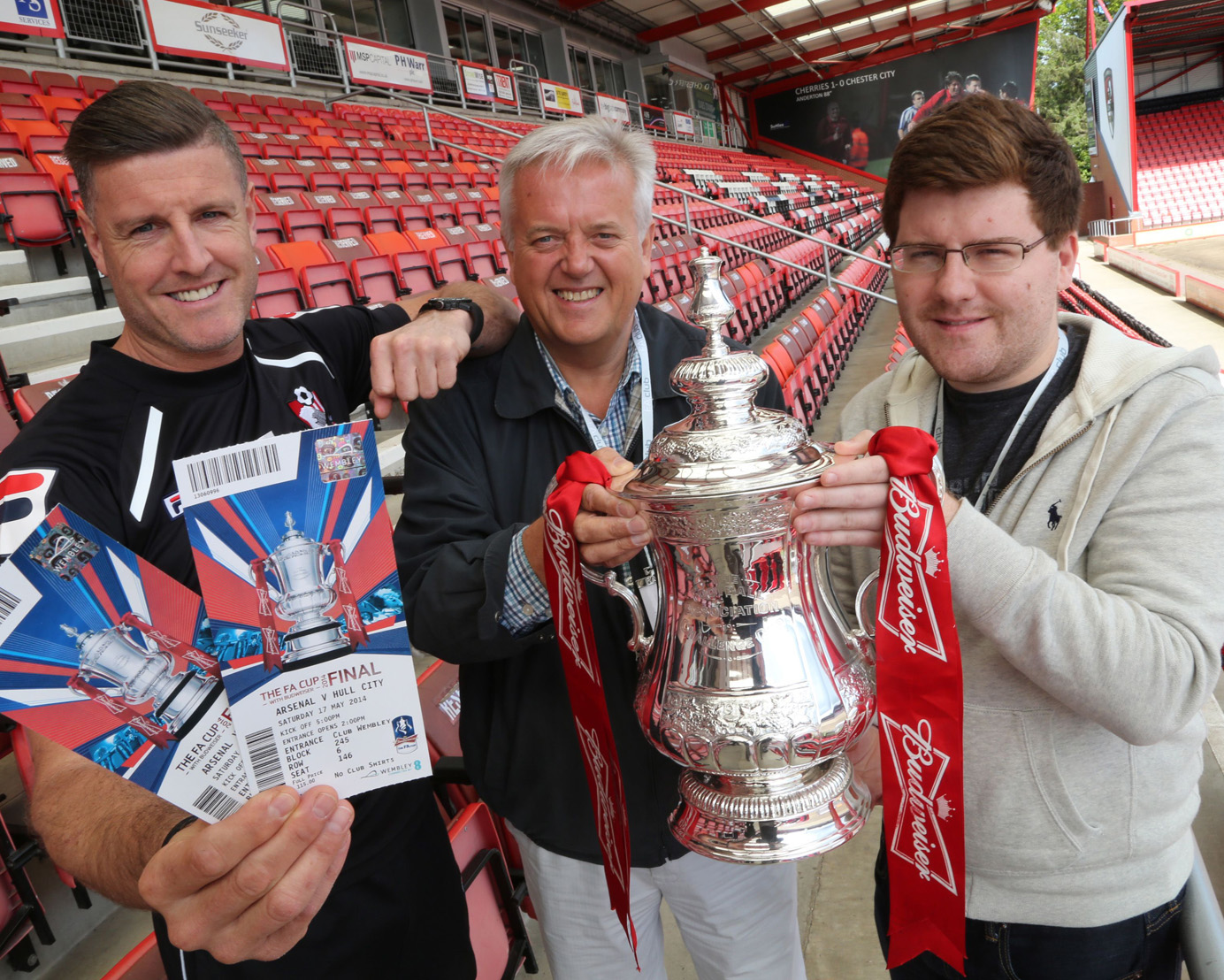 CUP KINGS: AFC Bournemouth supporters David Whitehead and Adrian Lee with the FA Cup and Steve Fletcher