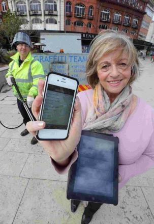 BECAUSE I'M APPY: Cllr Anne Filer, promotes the My Bournemouth app which enables Bournemouth residents to report problems like graffiti