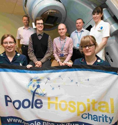 CASH INJECTION: Poole Hospital's Radiography Unit team celebrate the late Norman Barrett's gift