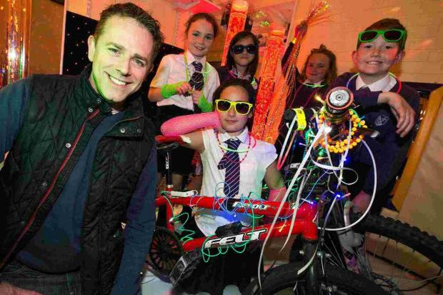 GLOW IN THE DARK: Chris Jarvis with pupils from Bethany School