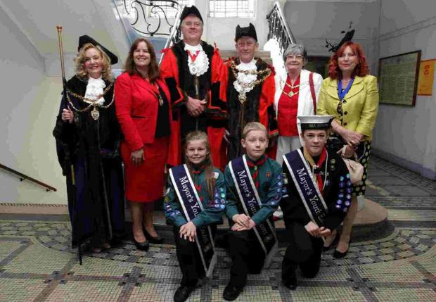 DIGNIFIED: From left are Sheriff councillor Jo Clements, Deputy Mayoress Helen Eades, Deputy Mayor councillor Phil Eades, Mayor councillor Peter Adams and the Mayoress Brenda Adams, Sheriff's escort Annette Kent along with the three young escorts