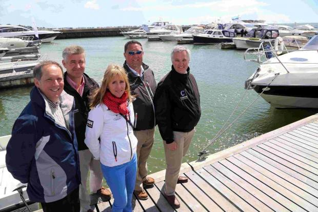 John Eads, with Tony Pauffley, Jane Haas, Marketing Co-ordinator for Salterns Marina, Russell Hayden, of Salterns Brokerage, and Andrew Skinner, Head of Marine and Private Clients at Coleman Insurance
