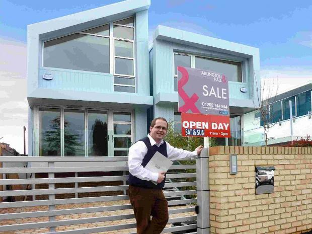 TIGHT FIT: Gary Berendt, realty consultant for Arlington and Hall, outside 3 Grasmere Road, where two small five-metre wide properties have been built, created by Eddie Mitchel