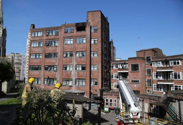 Bournemouth Echo: 60 firefighters battle blaze on top floor of student block in Bournemouth