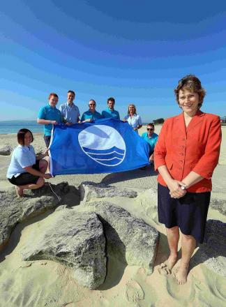 SANDS: Cllr Xena Dion, together with the Sandbanks Beach Team, celebrates Poole's designation as a Blue Flag beach