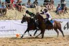 SADDLE UP: Action from last year's Beach Polo Championships
