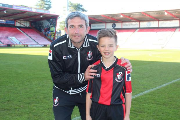 YOUNG STAR: Seven-year-old Harry Redknapp signs for AFC Bournemouth