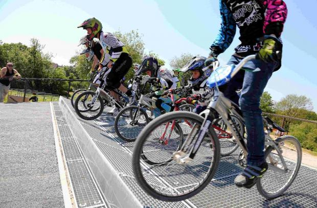 BMX riders enjoy a day of racing to mark the group winning funding