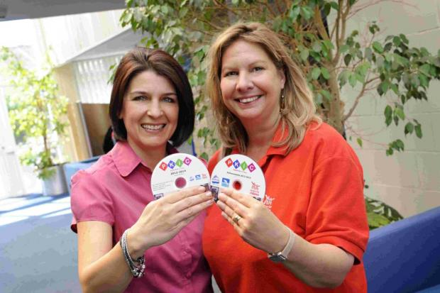 PROUD: Caroline Donnell of JP Morgan and Aldina Taylor of Action for Children with the DVD