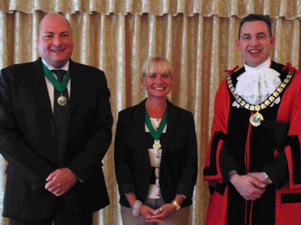 Bournemouth Echo: YOUNGEST: Ferndown mayor, Councillor Mike Parkes, with, left, deputy mayor Cllr Tony Brown and deputy mayoress Billie Brown