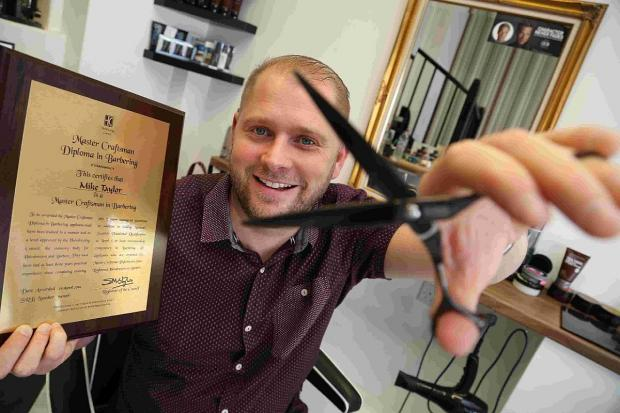 A SNIP: Mike Taylor in his shop Master Barber's in Poole
