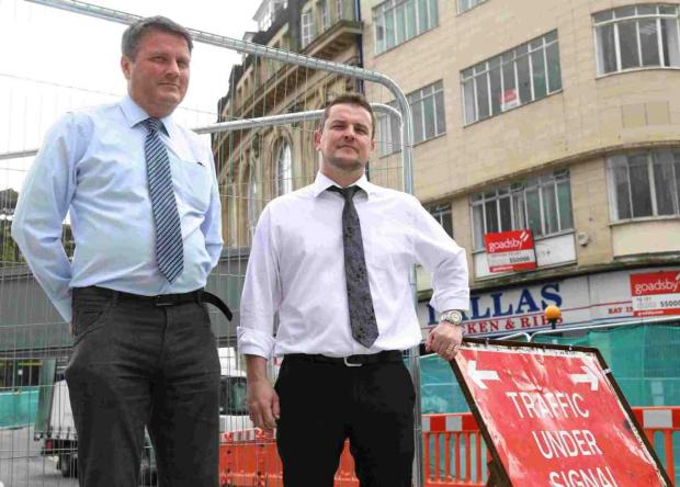 UNCERTAIN FUTURE: James Rhodes, left, group manager of GE Bridge with Michael Carlili, shop manager