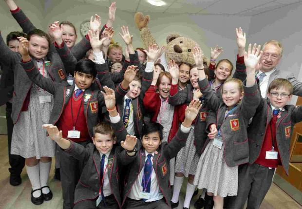 IN TUNE: Year six pupils from St Thomas Garnet School in Boscombe meet Lewis the Bear at Lewis-Manning Hospice