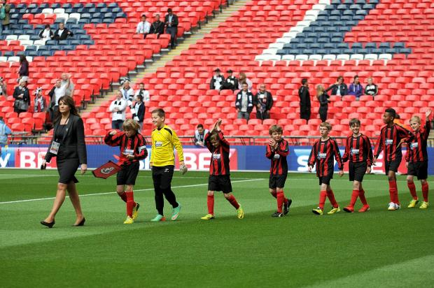 BIG DAY: St James' Primary School take to the pitch