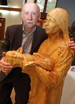 Canon Dr Bill Merrington with his lifesize sculpture of Mother Teresa