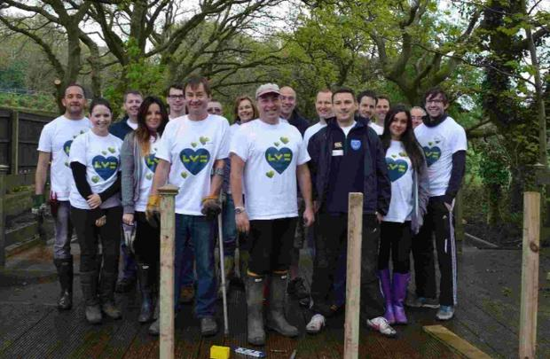 HELPING OUT: Volunteers from LV= hard at work in Langside School's sensory garden