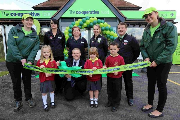CELEBRATION:  Co-op manager Richard Gallop with staff and children