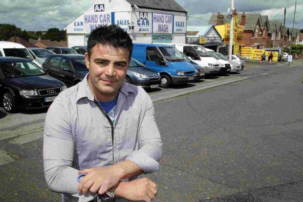 Bournemouth Echo: APOLOGY WANTED: Aram Akrami, owner of the AA Clock Garage