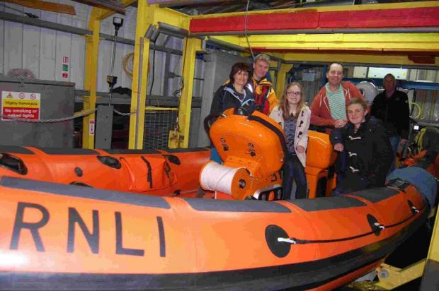 Rachel Matthews with representatives from the RNLI