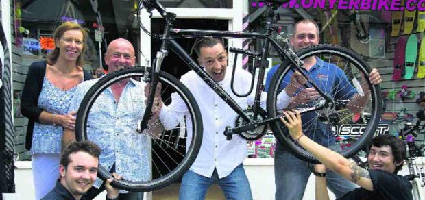 ON YER BIKE: Carl Owen with staff and owners
