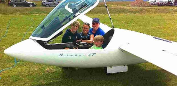 PLANE AND  SIMPLE: Mark Wering with wife Sarah and sons Matthew and Daniel