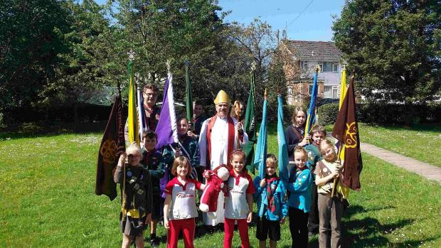 VISIT: The Right Rev Graham Kings pictured with youngsters