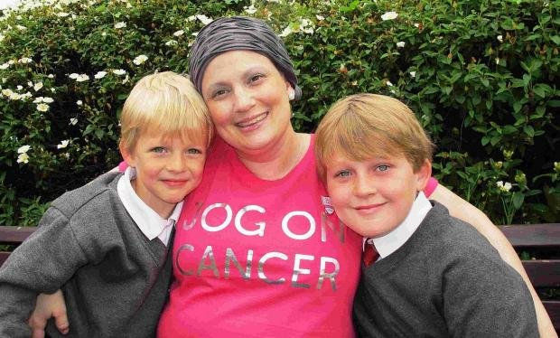 PINK LADY: Abbe Bladdon with sons Lewis and Blake