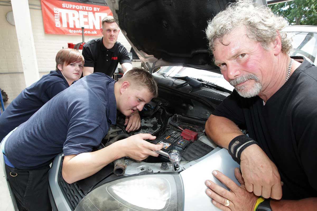 FIXERS: From right, mechanic instructor Nick Downs, Adam Brown and Holly McMullen, both 16,  and Martyn Akehurst from Trent's vehicle recycling and parts