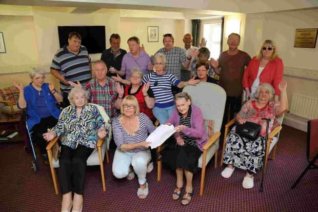 LOUNGE: Joan Bourne, front centre, with other residents of  Harcourt Grange in Southbourne