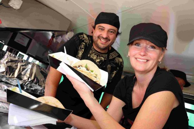 Jose Raul and Tiffany Miramon with tacos at Bournemouth Food Festival