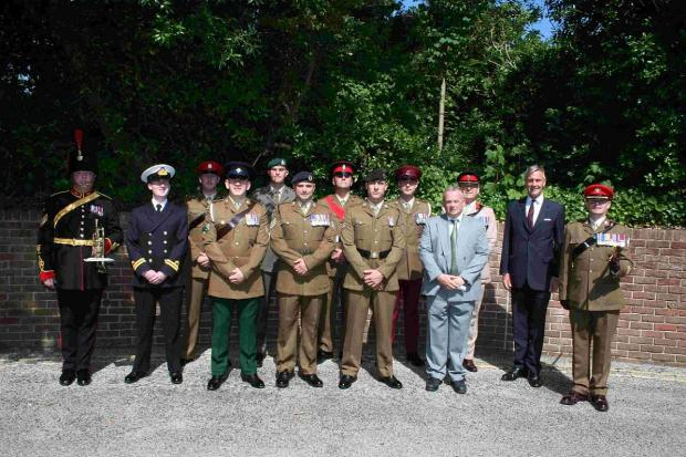 ARMED FORCES: Picture shows Colonel John Ogden, David Stanfield, Richard Drax MP, Councillor Gary Suttle, a trumpeter from The Royal Artillery Band, Tidworth and soldiers and marines based at Bovington and Lulworth
