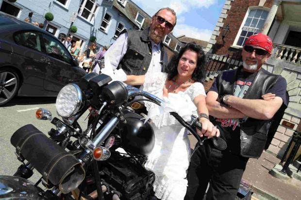 TRIKE: Gary Simpson and his bride Caz, and best man Jeff Cooper.