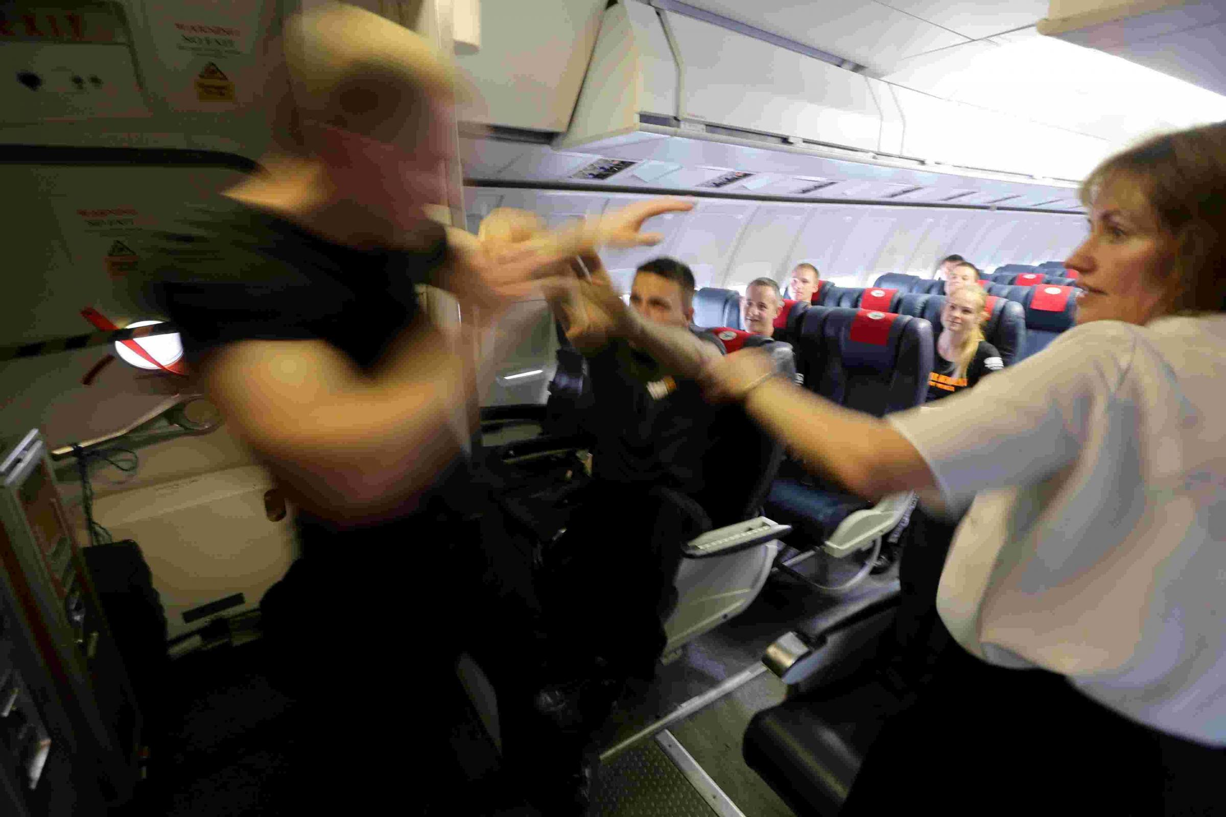 VIDEO: Watch 'hostages' take over a plane in self-defence wor