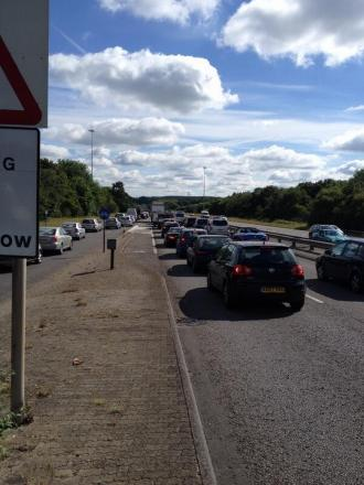 Traffic back to Cooper Dean roundabout after earlier crash on Spur Road