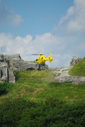 The Air Ambulance lands at Corfe Castle. PIc by Martin Yirrell