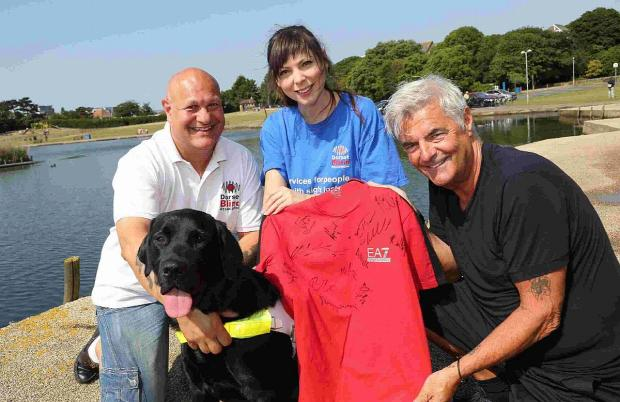 DONATION: Jaya Da Costa and Chris Ford with Eddie Mitchell and the signed shirt
