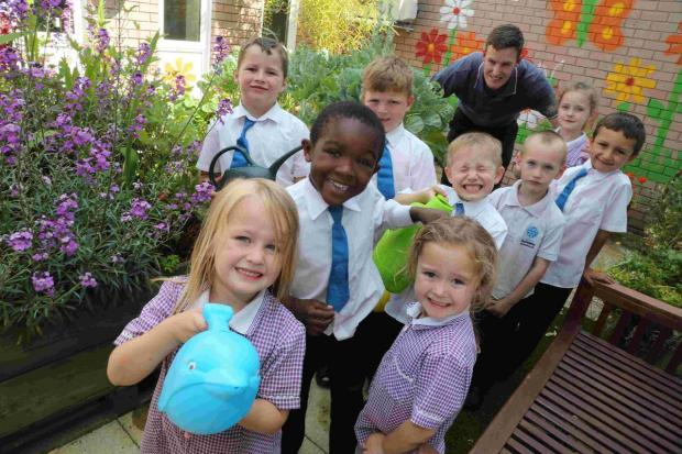 FUN: Children at an after-school gardening club at the Jewell Academy with co-ordinator Chris Brown