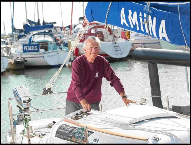 LAST: Edward Hooper is celebrating after setting a new record in a yacht race around the Isle of Wight